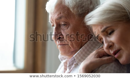 Closeup shot of aged couple, back to back Stock photo © stockyimages