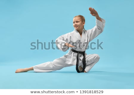 Woman sitting in combat stance Stock photo © pzaxe