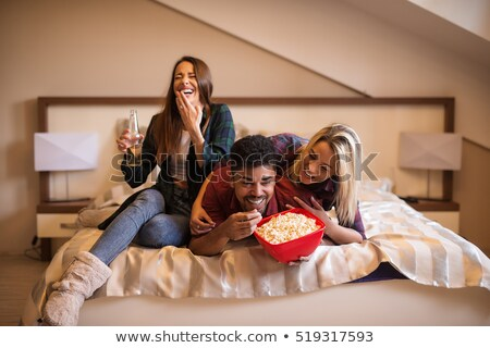 Blond woman and brunette having fun in bed stock photo © CandyboxPhoto