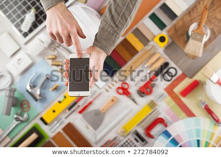 Decorator displaying mobile phone Stock photo © photography33