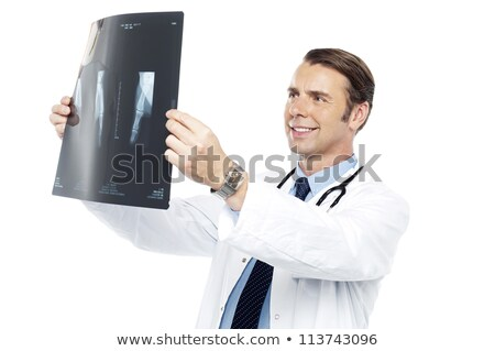 Experienced surgeon reviewing x-ray report Stock photo © stockyimages