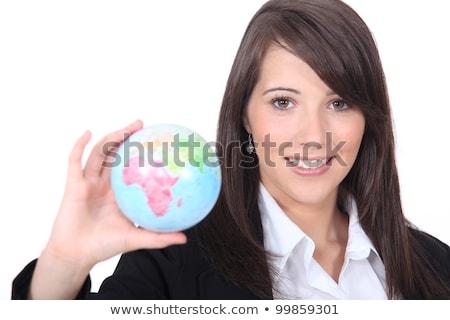 Brunette holding miniature globe Stock photo © photography33