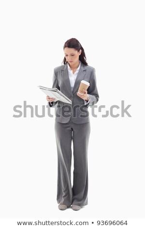 businesswoman reading newspaper against white background stock photo © wavebreak_media
