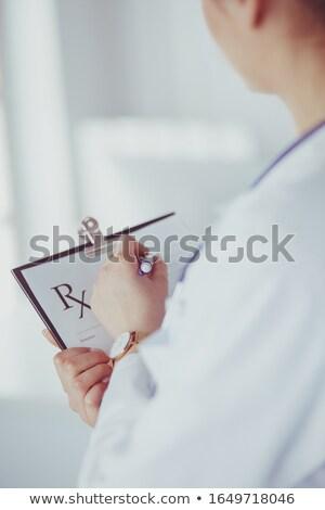 jonge · vrouw · arts · stethoscoop · pen · hand - stockfoto © nobilior