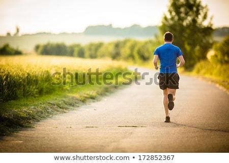 Male athlete runner running city Stock photo © HASLOO
