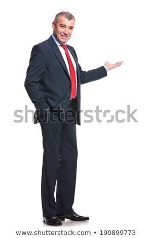 Stock fotó: Mosolyog · üzletember · kéz · a · kézben · zseb · dől · fehér