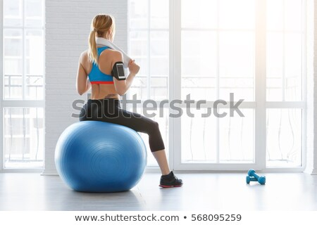 fitness woman working out with band stock photo © stockyimages