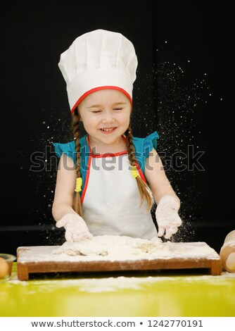 Chef tossing dough while making pastries Stock photo © juniart