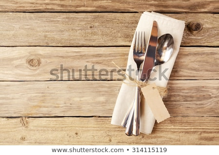 Spoon knife and fork on the wooden board. Stock photo © justinb