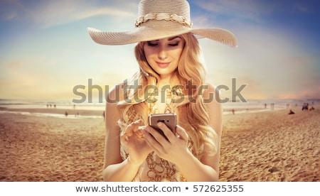 Sarışın moda kadın telefon model Stok fotoğraf © lunamarina