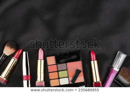 Beautiful picture of cosmetic  on black satin Stock photo © alekleks