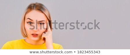 Thoughtful brunette standing hand on temple Stock photo © wavebreak_media
