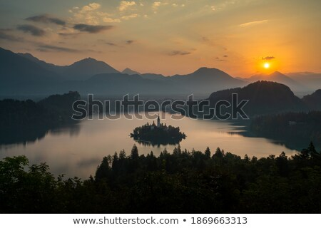 Silhouette of Bled Castle on a Lake Stock photo © Kayco