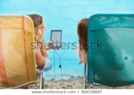 girl listens to music while sunbathing Stock photo © adrenalina