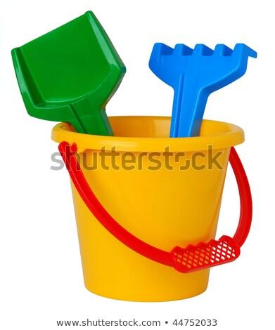 toy bucket and shovel on an empty beach stock photo © tish1