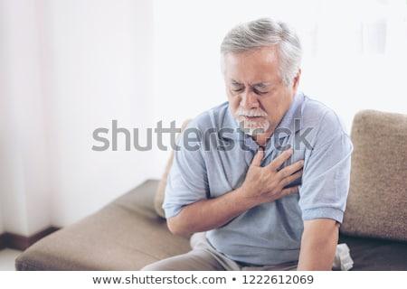 jonge · man · hartaanval · man · lijden · borst · pijn - stockfoto © kalozzolak