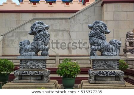 old stone lion sculpture Stock photo © LianeM