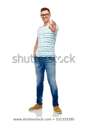 Jonge man bril tonen handteken gebaar Stockfoto © dolgachov