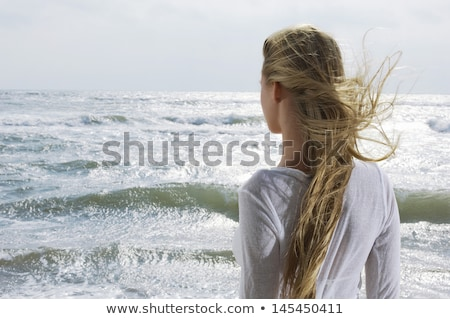 rear view of beautiful blond caucasian woman stock photo © julenochek