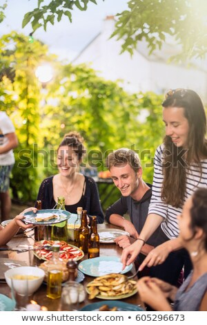 group of young people around barbecue stock photo © is2