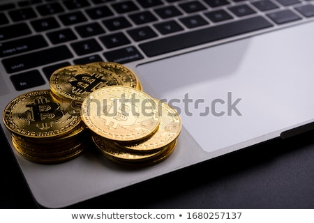 Bitcoins on computer keyboard Stock photo © stevanovicigor