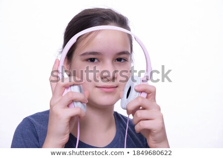 Teen girls put on headphones Stock photo © IS2