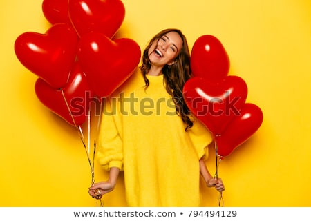 girl with red hair on a yellow background a charming girl in transparent glasses sits on a white ch stock photo © traimak