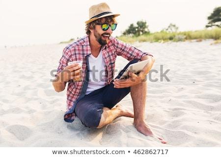 portrait · heureux · jeune · homme · chapeau · permanent · souriant - photo stock © deandrobot