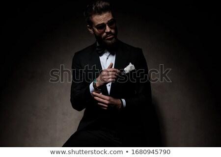 Jonge bruidegom opening smoking permanente witte Stockfoto © feedough