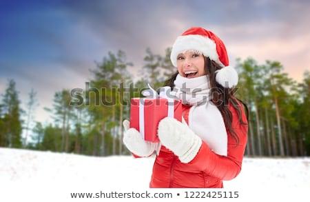 gelukkig · vrouw · hoed · geschenk · vakantie - stockfoto © dolgachov