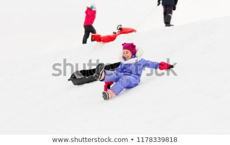 happy little kids sliding down on sleds in winter Stock photo © dolgachov