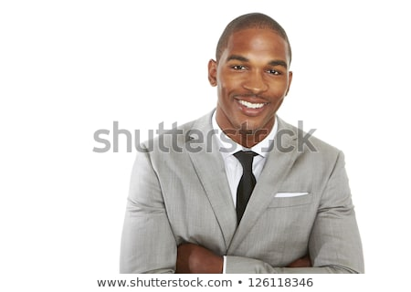 Young man of African ethnicity standing in front of camera in isolation Stock photo © pressmaster