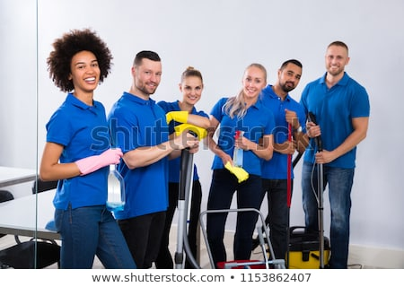 Diverse Young Janitor With Cleaning Equipment Stock photo © AndreyPopov