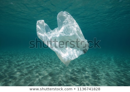Water pollution with plastic bags in ocean Stock photo © bluering