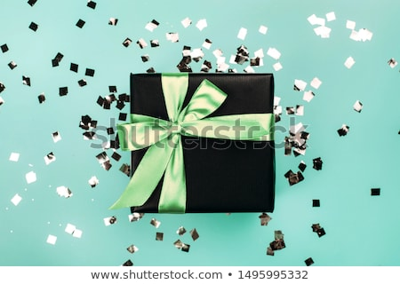 Luxury black gift boxes with green ribbon  Stock photo © Illia