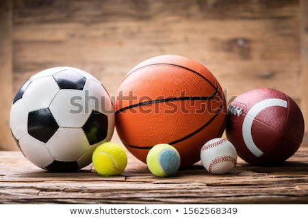 Sport Balls Arranged Over Rough Plank Stock photo © AndreyPopov