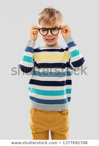 smiling boy in glasses and striped pullover Stock photo © dolgachov