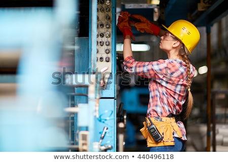 Női villanyszerelő portré piros szalag kábelek Stock fotó © photography33