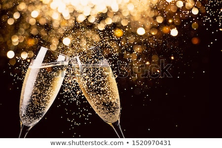 Glittering champagne glasses Stock photo © glyph