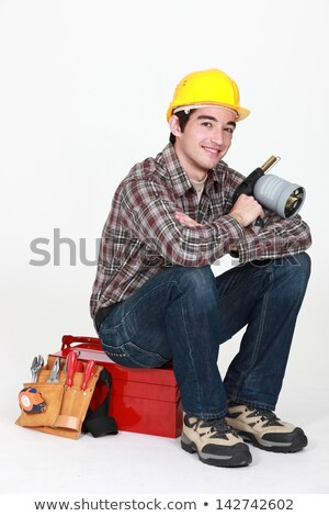 Tradesman holding a blowtorch and sitting on his toolbox Stock photo © photography33