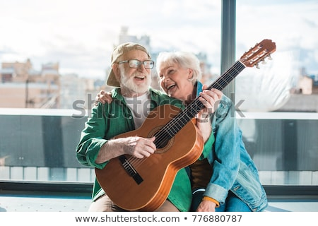 Couple playing musical instruments Stock photo © photography33