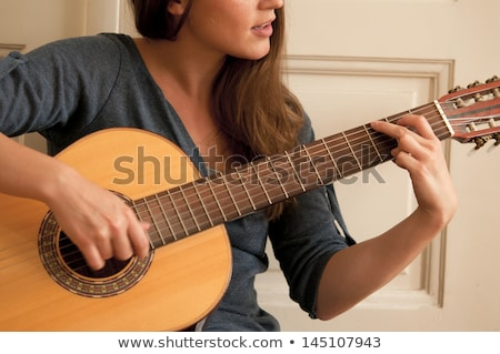 Brunette holding acoustic guitar Stock photo © photography33