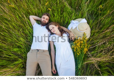 couple · vers · le · bas · parc · femme · fleurs · heureux - photo stock © get4net