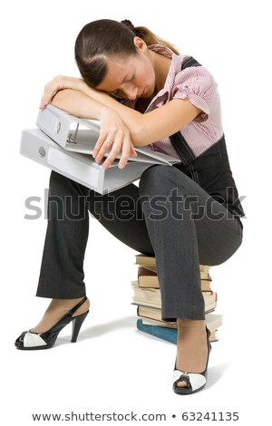 Overworked woman sleeping on a stack of books Stock photo © photography33