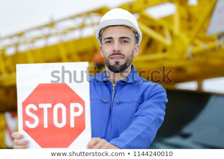Tradesman holding a stop sign and a megaphone Stock photo © photography33