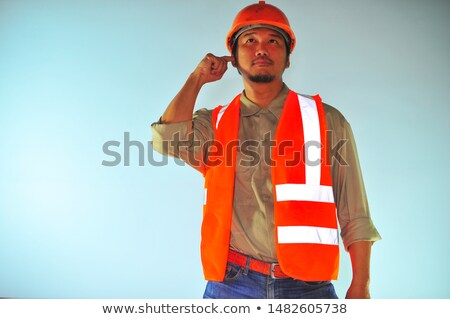 Engineer putting his finger to his head Stock photo © photography33