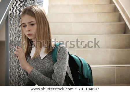offencive schoolgirl Stock photo © dolgachov