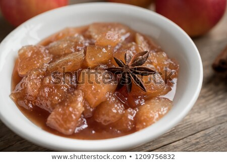 Apple jam with cinnamon and fresh fruits with leaves Stock photo © yelenayemchuk
