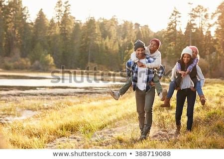 Anya apa gyerekek háton kert csoport Stock fotó © wavebreak_media