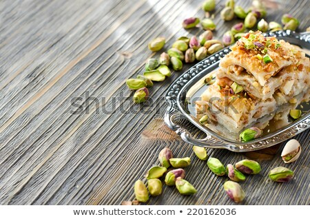 pistachios on  wooden  background stock photo © kornienko